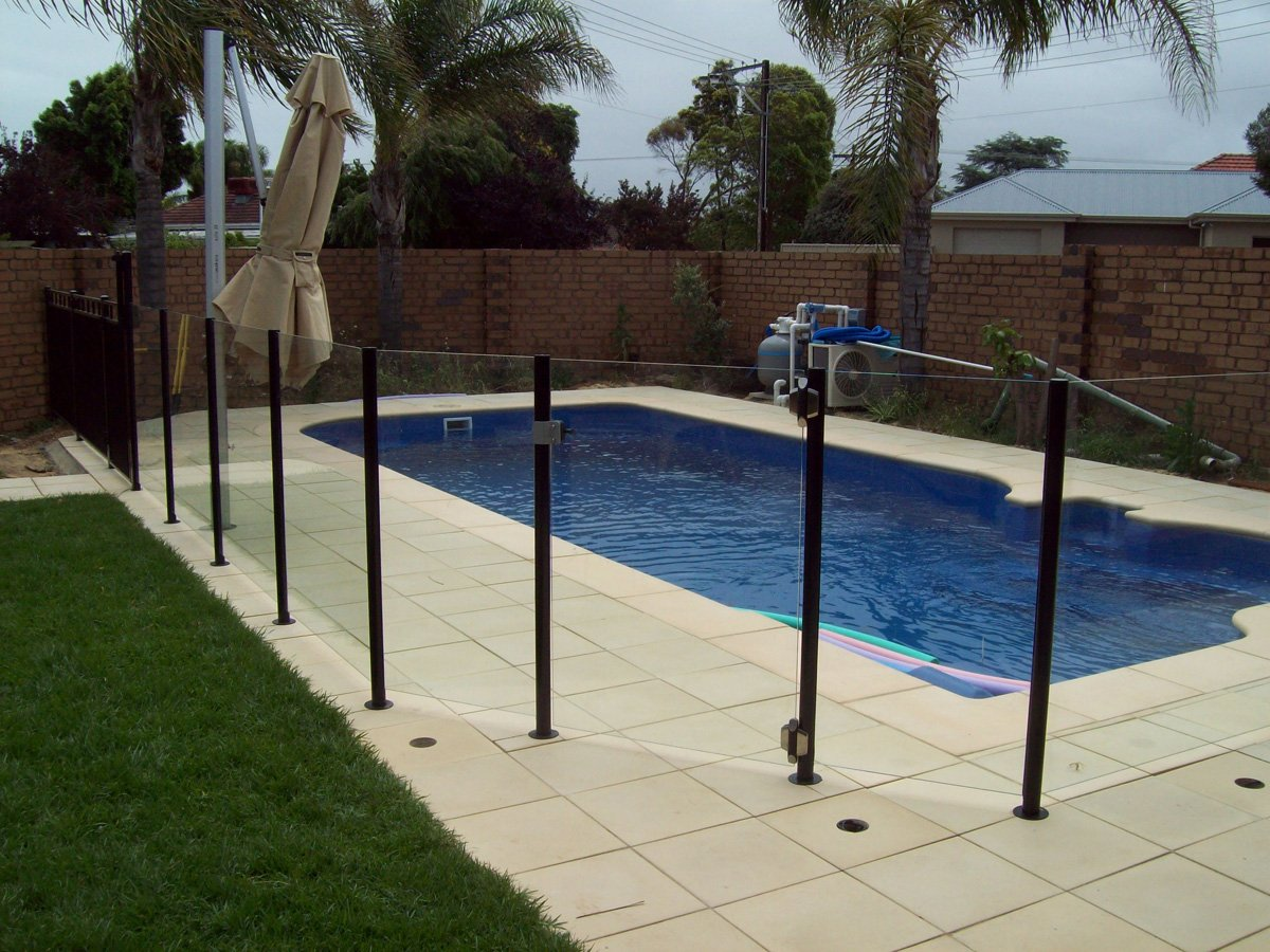 Semi frameless glass pool fences adelaide balustrade for Glass pool fences